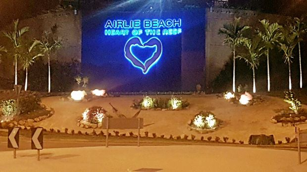 ACTION: The lights are on at the new Airlie Beach sign.