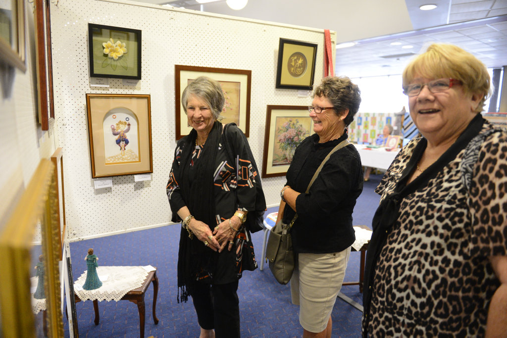Coffs women (from left) Gillian Simpson, Robyne Bunter and Margaret Tozer were looking at the Jacaranda Embroidery Exhibition at the South Grafton District Exservicemen's Club on Saturday. Photo Debrah Novak / The Daily Examiner
