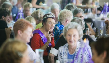 Jacaranda Queen Emily Causley gets in among the large crowd at the Inner Wheel lunch at the Grafton Golf Club. Photo Adam Hourigan / The Daily Examiner