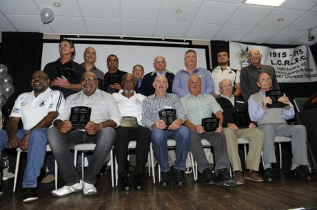 Magpie players receive their 'Legends' awards (from left) Steve O'Sullivan, Wayne McCarron, Greg Randall (for Dale Randall) John Gahan, Gary Want, Garry Chapman, Ryan Binge and Bill McCarron. (Fron Row) Foxy and Michael Laurie (for Raymond Laurie), Steven Laurie, Dick Ensby, John Brown, Bernie Plater and Jimmy Hopper at the Lower Clarence Magpies Centenary celebrations at the Maclean Bowling Club on Saturday night. Photo Debrah Novak / The Daily Examiner