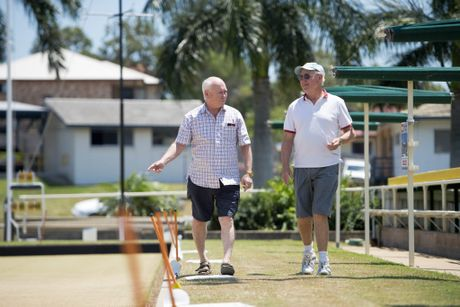 SECURING THE GREEN: Committee member Dave Olsen and chairman Peter pershouse at the Gladstone Bowls Club.