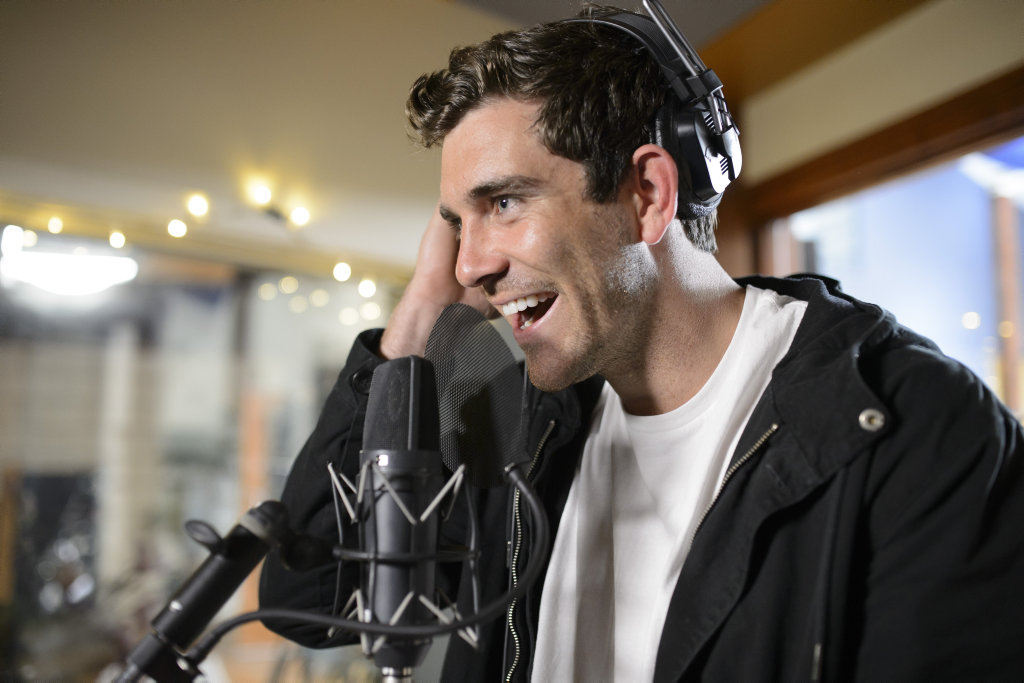 Cameron Cranley sings during a group date in a scene from The Bachelorette.