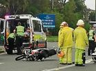Emergency services attend to a crash between a motorcycle and a car on Bradman Ave on February 7, 2016.