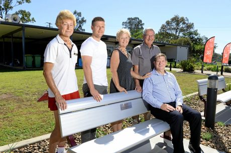 Del Rowlings' family poses at the tribute bench to Del at the George Alder Tennis Centre on Thursday.