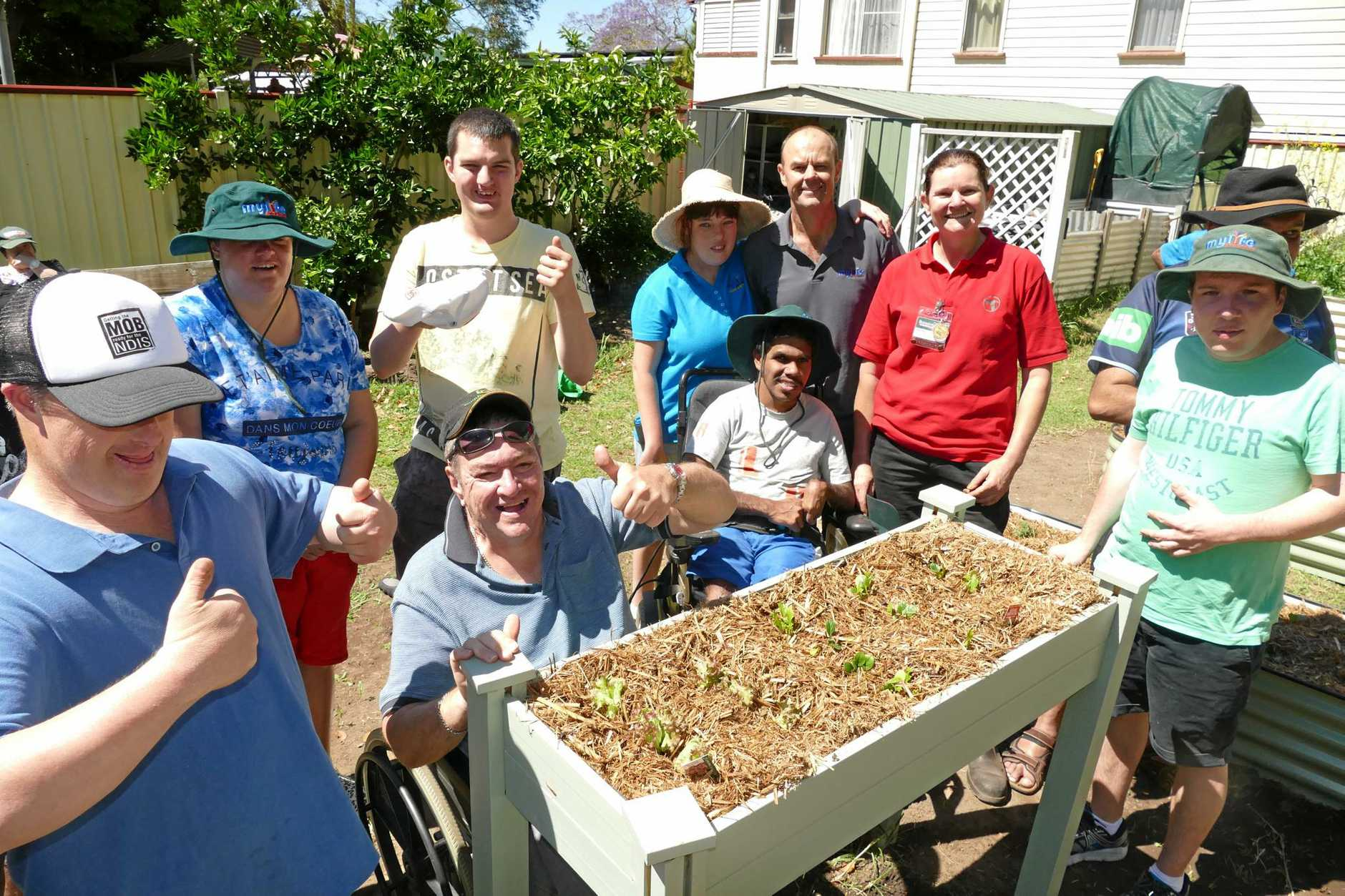 GOOD JOB: MyLife programs coordinator Adrian Baker and Bunnings activity organiser Toni Kearney and some of the MyLife participants check out the wheelchair accessible garden beds.