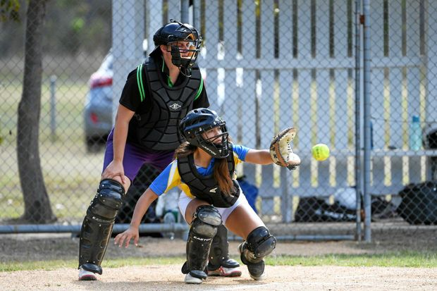 STRONG CATCHER: Aya Cedar-Green gets a wide ball during The Waves Tsunami's friendly match with Brothers United. The Waves were forced to forfeit with players unavailable for the match.