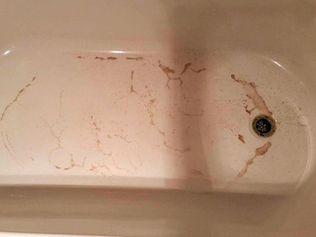 Sarina residents were alarmed by a brown-tinged water supply Monday. Karly Weeks said the water left her bathtub dirty.