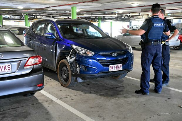STOLEN CAR: Police wait for forensic officers to arrive at Hinkler Central after a stolen Hyundai was found there.