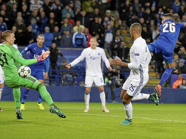 Leicester City's Riyad Mahrez scores against FC Copenhagen goalkeeper Robin Olsen during their UEFA Champions League Group G match.
