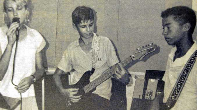 FRIDAY, APRIL 6, 1990: Getting the beat of their new song are James Nash State High School students (from left) Lindy Teed, Shane Duell and Dion Gadd. With teacher Neil Roche- Kelly, the students are preparing a demo tape in which they play or sing on several tracks. They are going to send the tape to a record company in the hope of finding success.