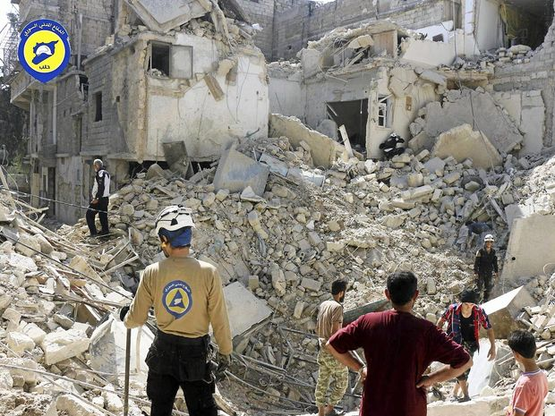 Syrian Civil Defence workers search through rubble in rebel-held eastern Aleppo.