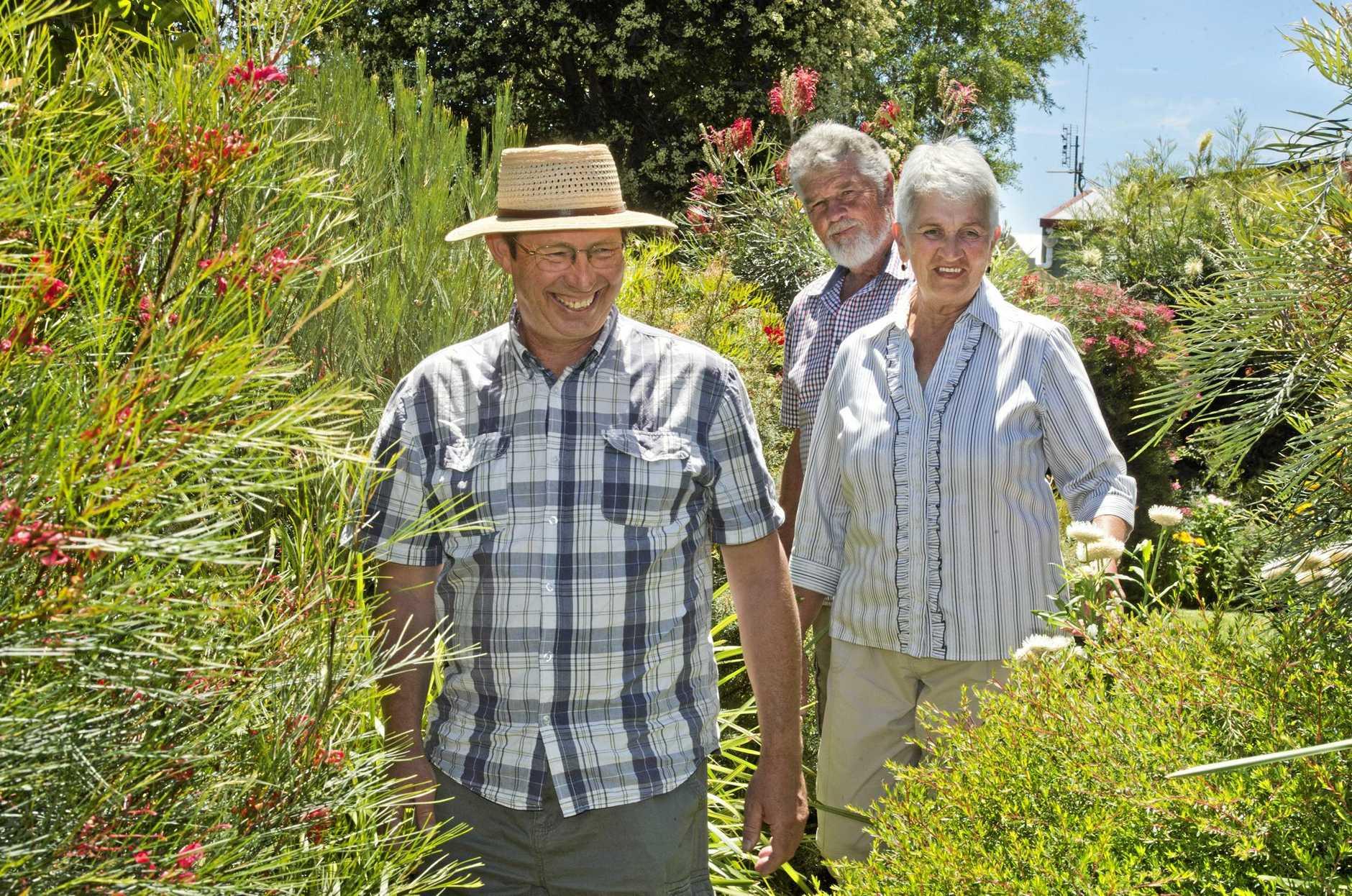NATIVE OASIS: Gardening Australia presenter Jerry Coleby-Williams (left) visits Highfields gardeners Gordon and Maria Reynolds to film a segment for the show's 2017 season.