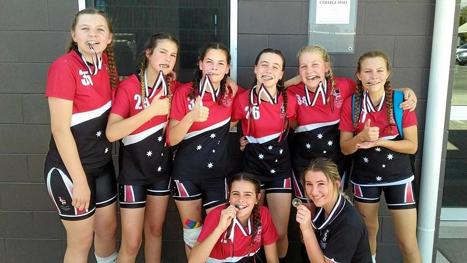 VOLLEYBALL STARS: Shiro Frid, coach Maddie White (front), Bronte Kruger, Khianna Buckley, Ebony Rathmell, Bronte Hayes, Hannah Nimmo and Zoe Turner (back) placed second at the Queensland Volleyball Junior Schools Cup in Brisbane.