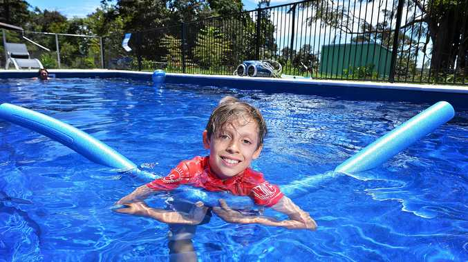 NOODLING AWAY: Young Kalani Kelly can at last enjoy a swim in a pool this summer, with money raised to convert his grandmother's pool to magnesium.
