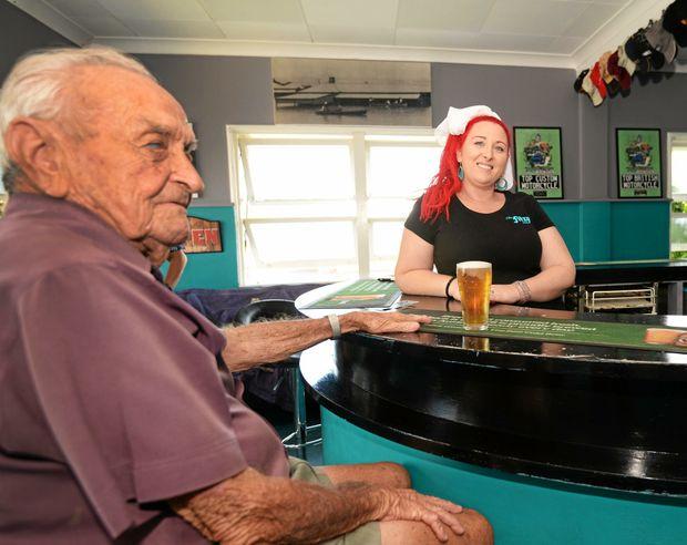 "Fitzroy Hotel's Tiana McGuigan serves local Alan \""Stumpy\"" Bradshaw a cold beerin the main bar."