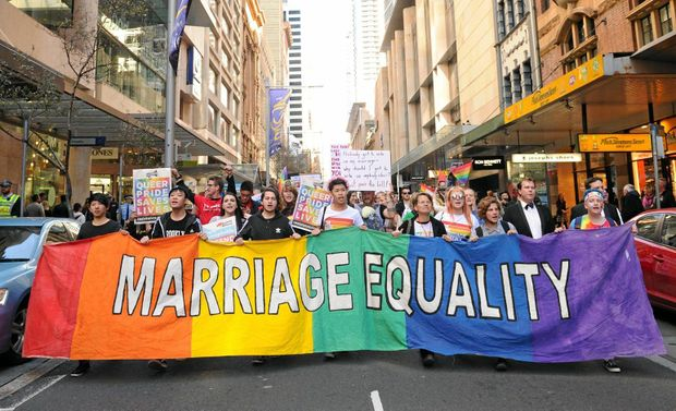 Supporters attend a marriage equality rally in Sydney, Saturday, Aug. 13, 2016. Supporters of marriage equality are calling on Members of Federal Parliament to pass legislation in Parliament, and avoid a same-sex marriage plebiscite which has been proposed by the Federal Government. (AAP Image/Joel Carrett) NO ARCHIVING