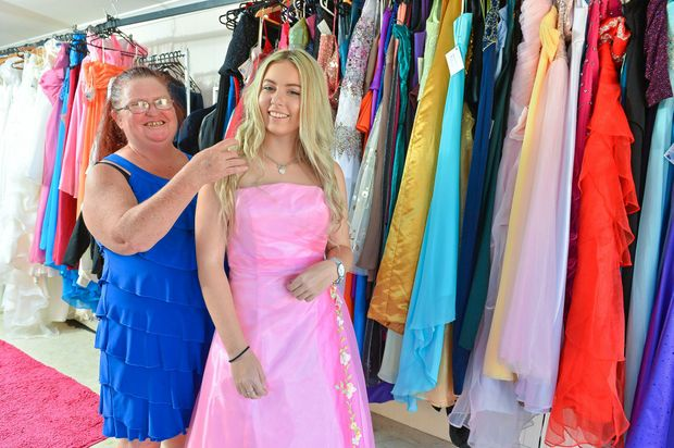 PERFECT FIT: Liz Snell helps Gladstone State High student Shari Johnson, 16, pick a gown for this year's formal.