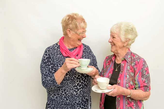 CHEERS: High tea organiser Dianne Wilson with charter member Jill Brown get ready to celebrate the Lower Clarence Quota club's 25th birthday.