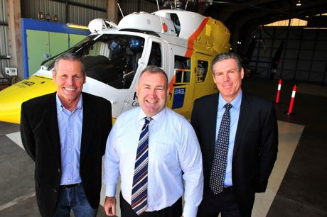 NEW BIRD: RACQ CareFlight ceo Ashley Van De Velde, Minister for Police and Community Safety Jack Dempsey and RACQ director Nigel Alexander unveil Bundaberg's newly painted RACQ CareFlight Rescue helicopter. Photo: Max Fleet / NewsMail
