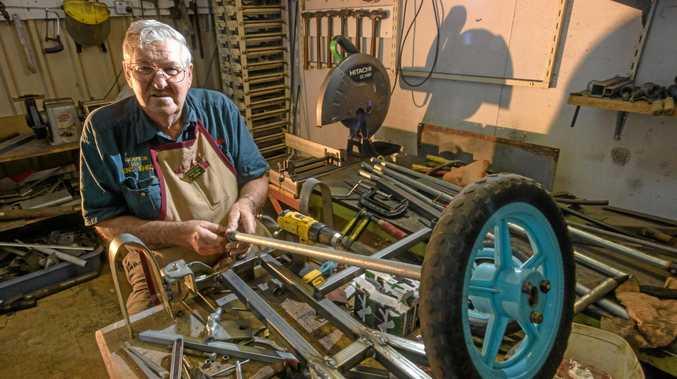 BUILT FOR SPEED: John Kliendienst of Grafton enjoys working on a cart for the Jacaranda Derby.