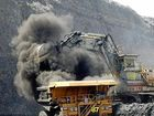 open cut coal mine. a mechanical shovel loads coal into a truck at the peak downs open cut coal mine. owned by bhp billiton mitsubishi alliance, near moranbah, queensland. - generic. coal, open cut, mines, mining, coal truck, big truck, drag line, fuel, fossil fuel, exports, environment. Monday 21 mar 05 afr    SPECIALX 34916Photo by Robert Rough