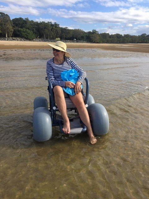 Sian Burrows can now feel the sand between her toes thanks to the beach wheelchair bought by the Lions.