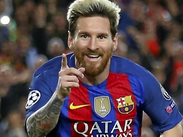 Barcelona's Lionel Messi celebrates after scoring his side's third goal during the Champions League Group C match against Manchester City at the Camp Nou.