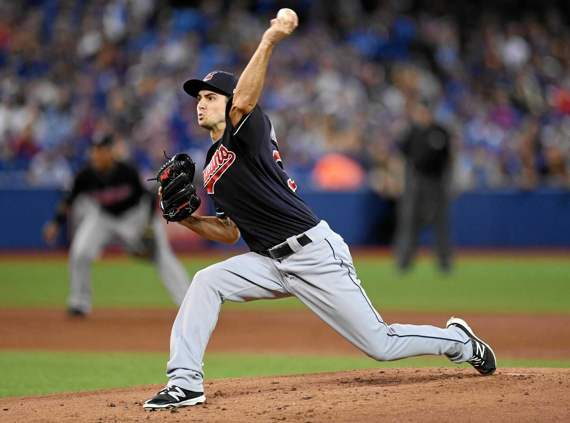 Cleveland Indians pitcher Ryan Merritt winds up against the Toronto Blue Jays.