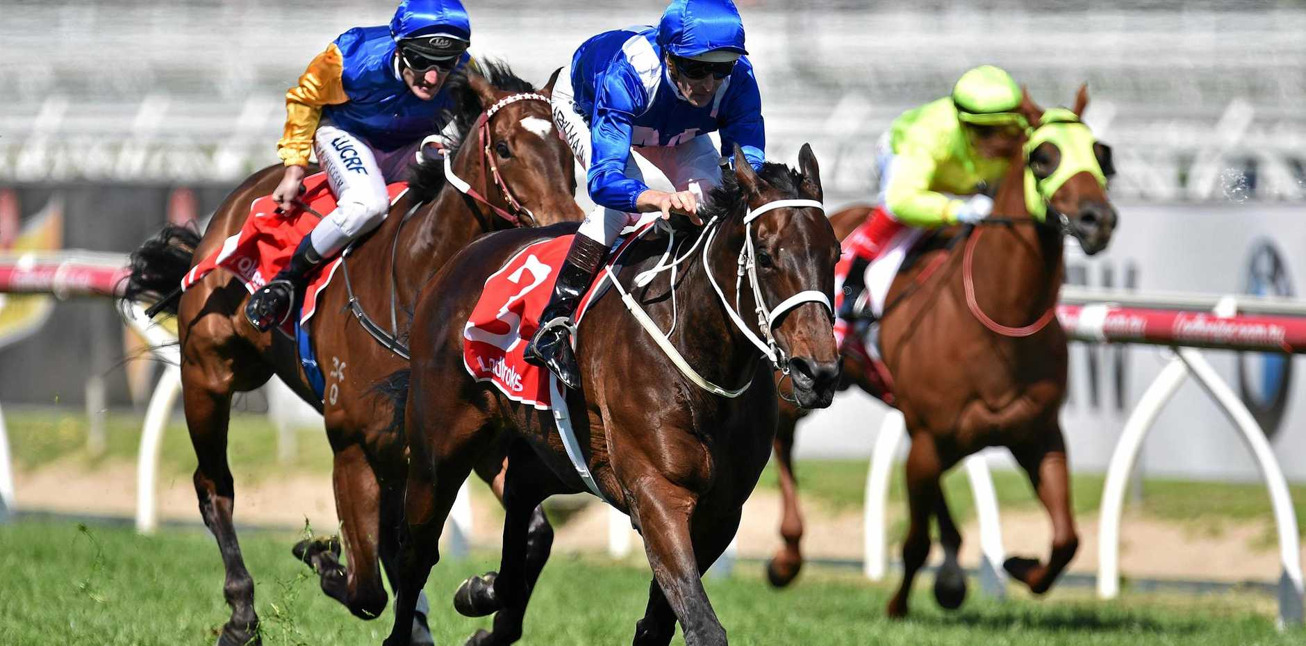 Hugh Bowman (centre) rides Winx to victory in the Caulfield Stakes earlier this month.
