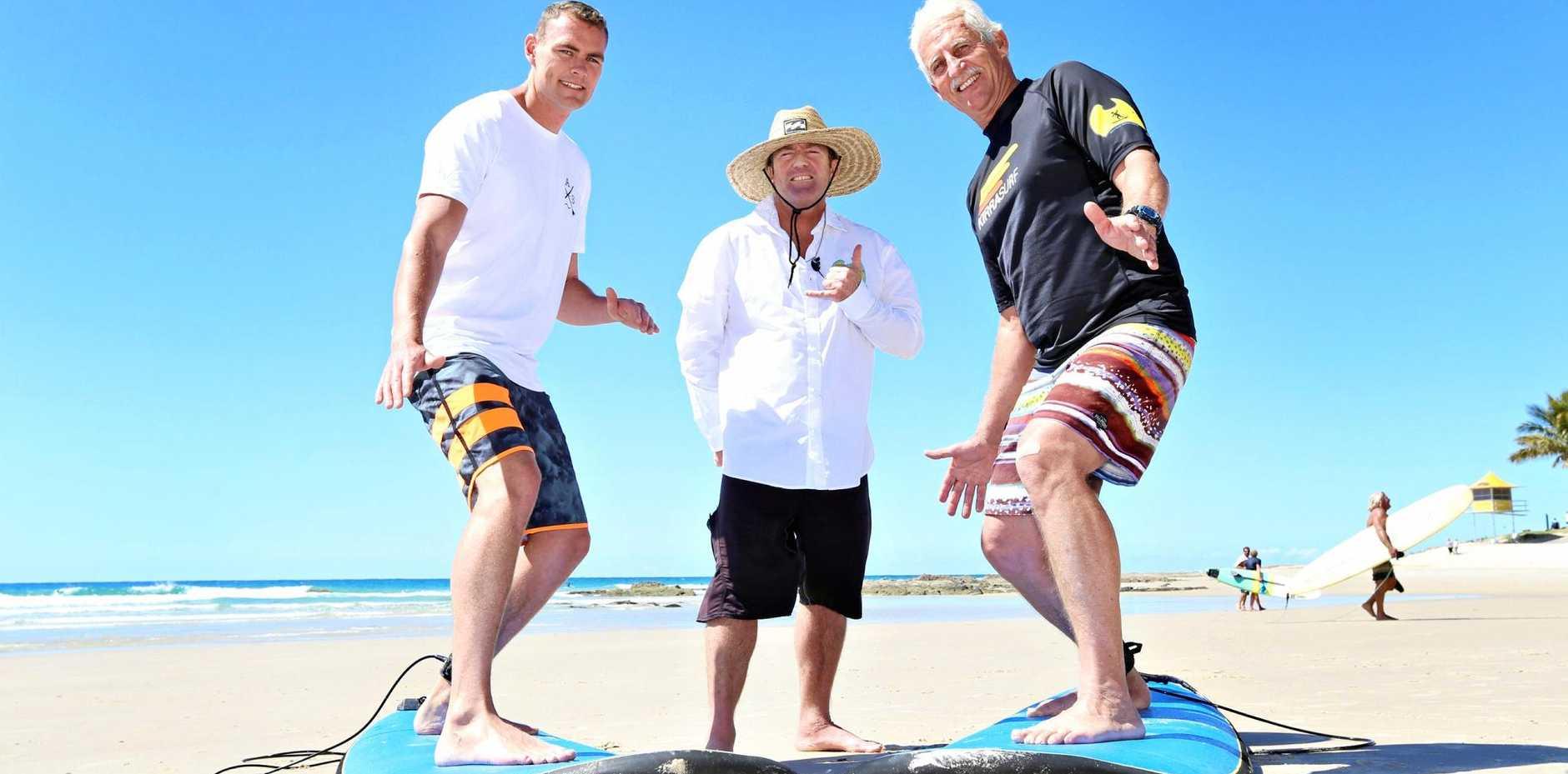 Glenn Filtness, surf instructor Dave Davidson, and Ken Campbell hit the beach ahead of Veterans' Health Week.