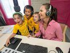 Year 2 Narranga school students on radio at CHYFM - Charlotte Rawson, Kallen Rau and Theo Holmes - with announcer Julie Moore.