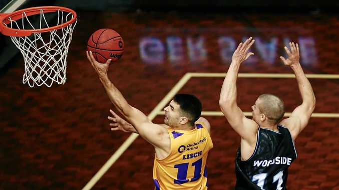 Kevin Lisch of Sydney scores against Ben Woodside of New Zealand during their round three NBL match.
