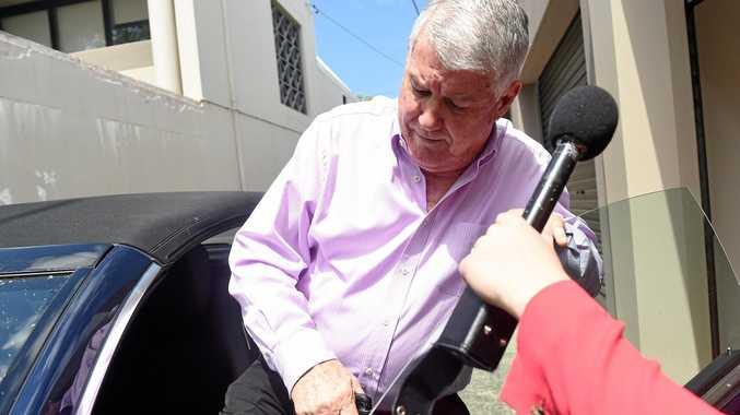 NRL player manager Wayne Beavis leaves his home in Sydney on Thursday.