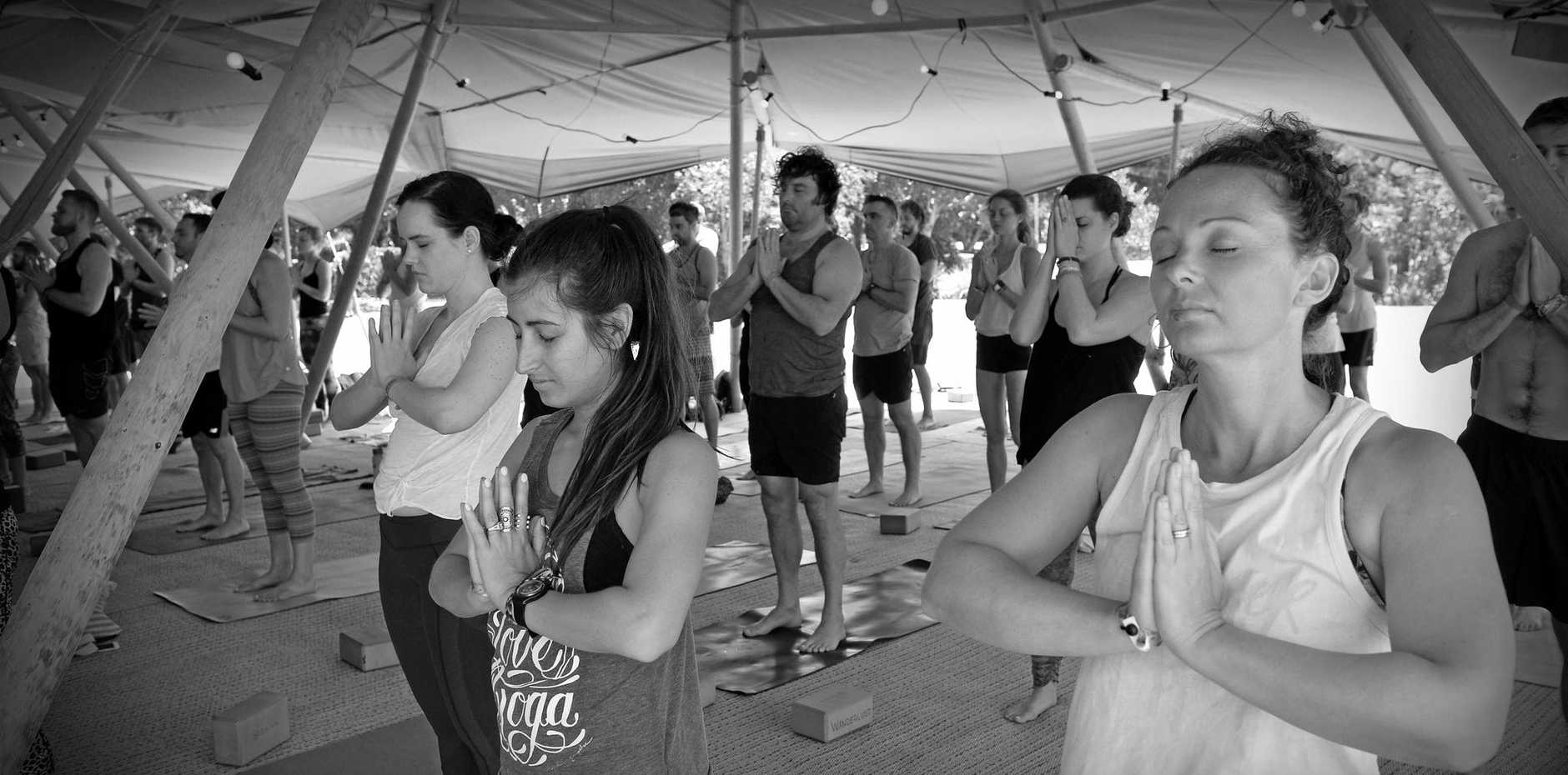 WANDERING SOULS: Visitors try yoga at Wanderlust at Novotel Twin Waters.