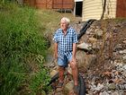 Woolooga's Barry Hawke is in a dispute with Gympie Regional Council over drainage behind his shops.