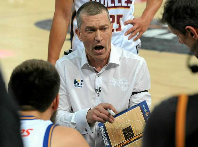 Brisbane Bullets head coach Andrej Lemanis gives instructions to his players during the round three match against Melbourne United.