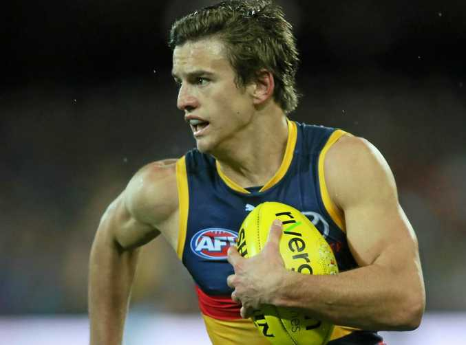 Adelaide's Jarryd Lyons runs with the ball. He will join the Suns next season.