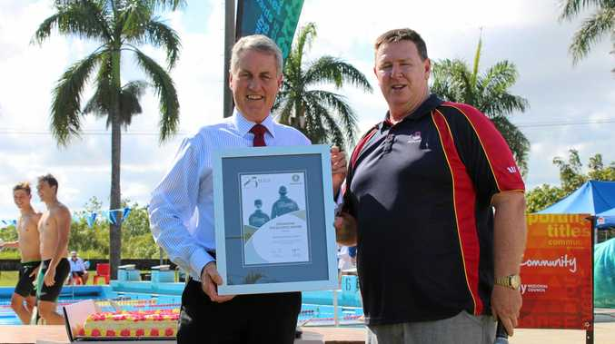 Mayor Greg Williamson accepted an excellence award from Surf Life Saving Queensland CEO John Brennan.