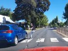 The woman was nearly struck by a car while on a pedestrian crossing on Hume St.