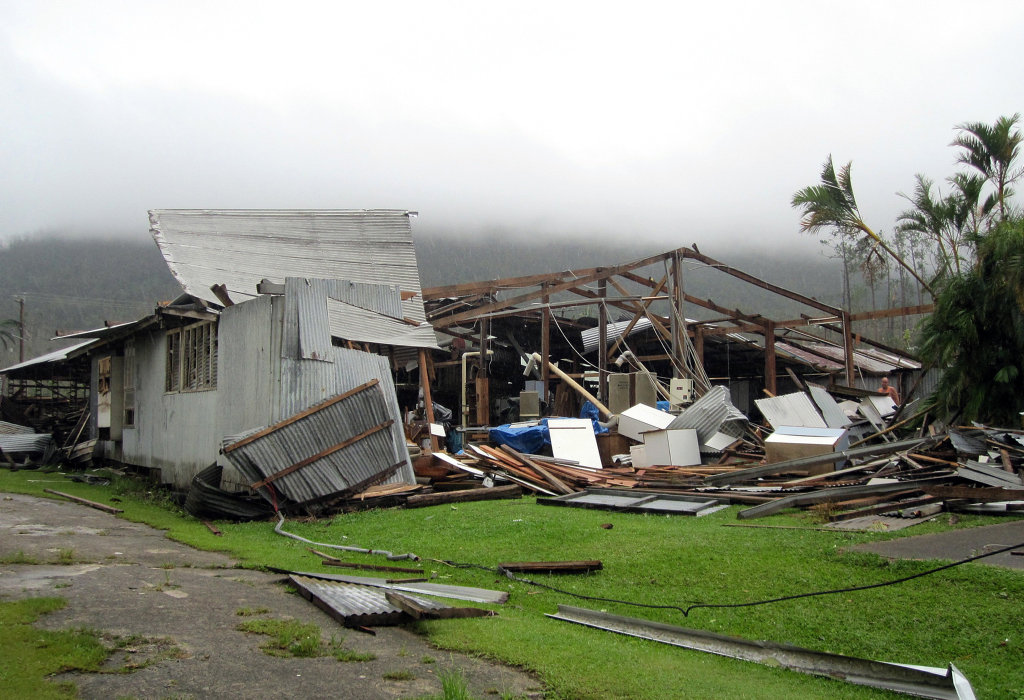 Damaged property is seen in Tully, North Queensland, Friday, Feb. 4, 2011, as a result of category 5 tropical cyclone Yasi which swept through the region the night before. (AAP Image/Maryann Uechtritz) NO ARCHIVING