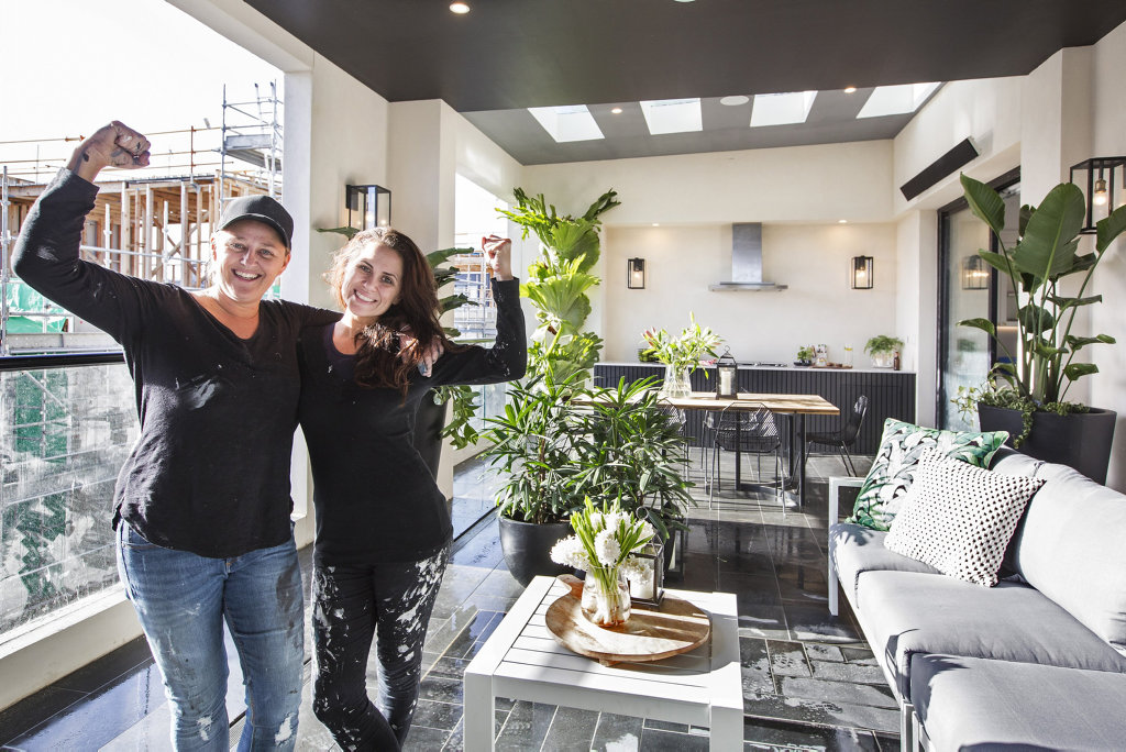 *WARNING EMBARGOED UNTIL 9pm Sunday October 23* Julia and Sasha pictured on their winning outdoor terrace in a scene from The Block.