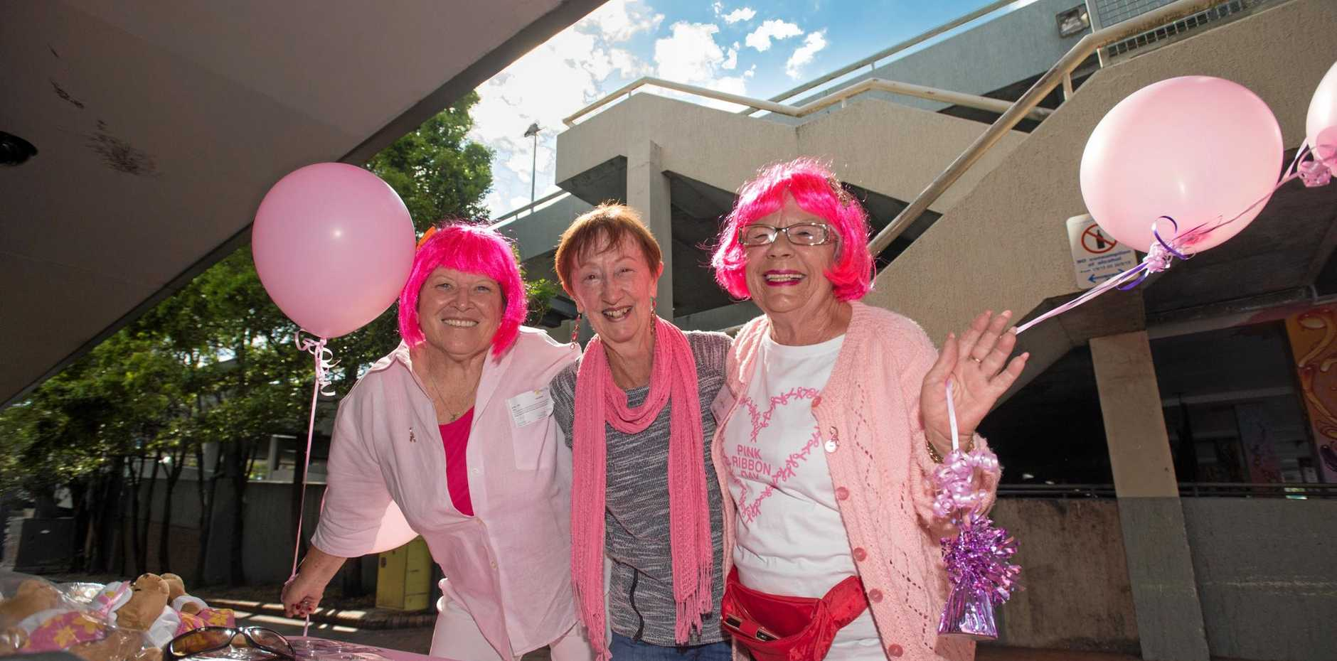 Denise Bass, Kathy Clough and cancer survivor Dorothy Lockart at Pink Ribbon Day stall in the mall.