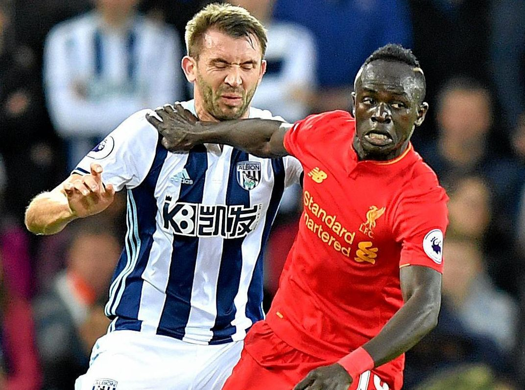 West Bromwich Albion's Gareth McAuley (left) and Liverpool's Sadio Mane battle for the ball.