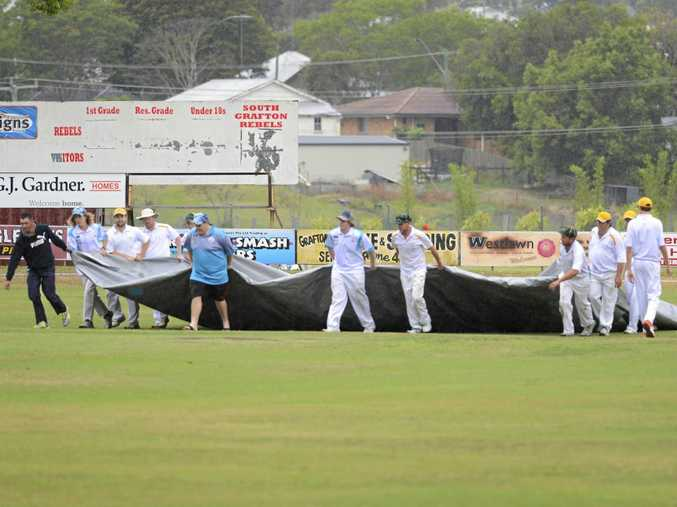 COVERING UP: Players drag the covers over the wicket at McKittrick Park   on Saturday.
