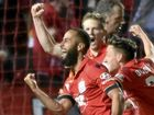 Tarek Elrich of Adelaide United celebrates his goal against the Victory.