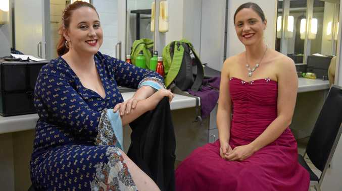 PERFORMERS: Brianne Bourke and Kathleen Campbell relaxing after performing in the open solo singing section for oratorios and cantatas.