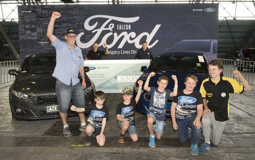 Auction winners with the final Ford Falcons prodcued in Australia.Photo: Contributed