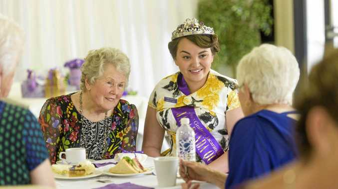 TRADITION: 1955 Jacaranda Queen Stella Wilson sits with reigning 2015 Jacaranda Queen Charlotte White at last year's Jacaranda Afternoon Tea.