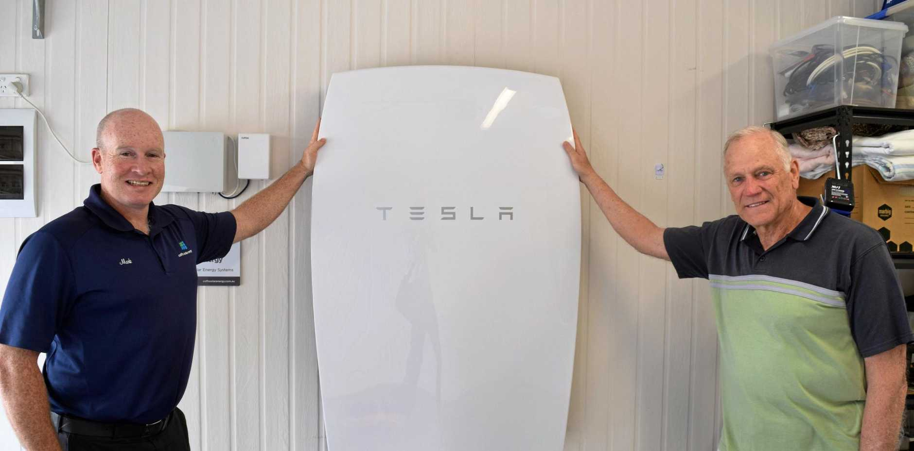 ON: Mark McClurg and Leslie McKay with the Tesla Powerwall.
