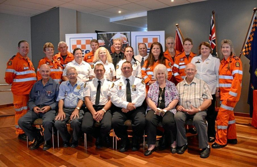 DEDICATED: The full complement of Gympie SES unit members who attended the North Coast Regional SES Awards on the weekend. (Back, from left) Don Fuller, Wayne Kerle, Alan Sage (chaplain), Ted Logan, Dennis Rossow, (centre) Jason Myatt, June Fuller, Mandy Price, Leonie Eaton, Pam Reis, Meaghan Bentley, Jess Tunnah, Jenny Millers, Tanya Easterby, (front) Ray Myers, Ray Morsch, Steve Clough, Dean Wardell, Margaret Setchell and Charlie Setchell.
